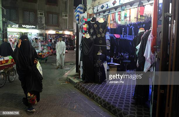 A woman walks at the popular market of Qabil street in the heart of Jeddah historic center on December 9 2015 in Jeddah Saudi Arabia The street which...