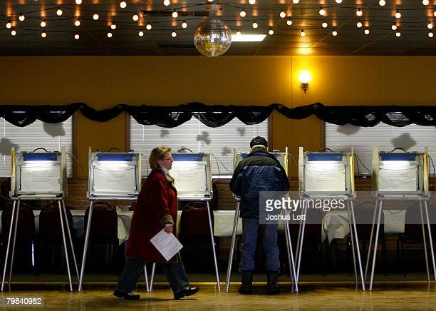 A woman walks away form a voting both after casting her ballot at Country Keg Pub Restaurant February 19 2008 in Cedarburg Wisconsin Despite frigid...