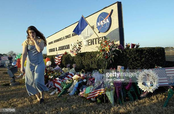 A woman walks away from a makeshift memorial outside NASA's Johnson Space Center for the seven astronauts who died when the Space Shuttle Columbia...