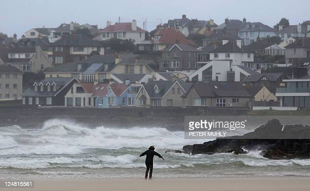 A woman walks backwards against the wind along Portstewart Strand beach in Portstewart Northern Ireland as the remnants of Hurricane Katia hit the...