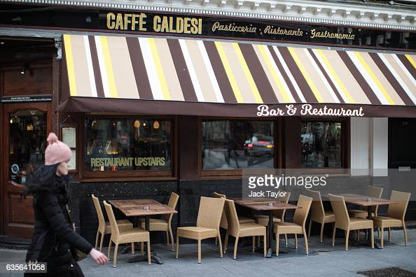 A woman walks by a Caffe Caldesi bar and restaurant in Marylebone on February 16 2017 in London England The Association for Licensed Multiple...