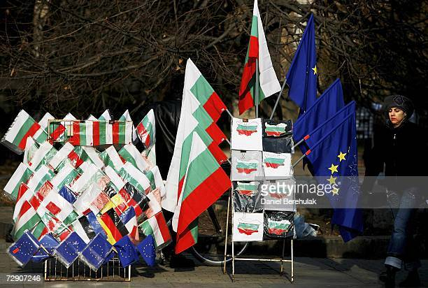 A woman walks by a street stand selling Bulgarian and EU flags on December 31 2006 in Sofia Bulgaria Bulgaria and Romania will join the European...
