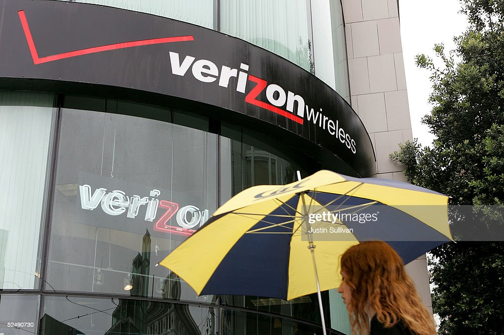 A woman walks by a Verizon Wireless store March 29, 2005 in San Francisco. MCI Inc. accepted a $7.64 billion takeover proposal from Verizon Communications Inc. on Tuesday that raises the price tag by $1 billion, but is still nearly a billion dollars shy of the latest bid from Qwest Communications International Inc.