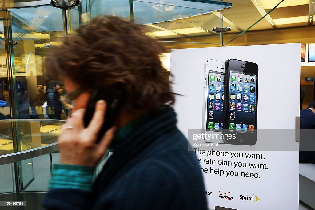 A woman walks by an advertisement for the iPhone 5 at an Apple store on January 14, 2013 in New York City. Responding to weaker than expected demand, Apple has cut orders for LCD screens and other parts for the iPhone 5 this quarter. Shares for the tech company fell more than 4 percent to $498.20 before the bell on Monday. Analysts see the slowing sales as evidence that the U.S. firm is losing ground to Asian smartphone rivals.