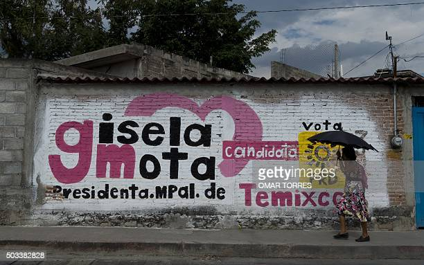 A woman walks by an electoral campaign mural of Gisela Mota the mayor who was gunned down a day after taking office in Temixco Morelos State Mexico...