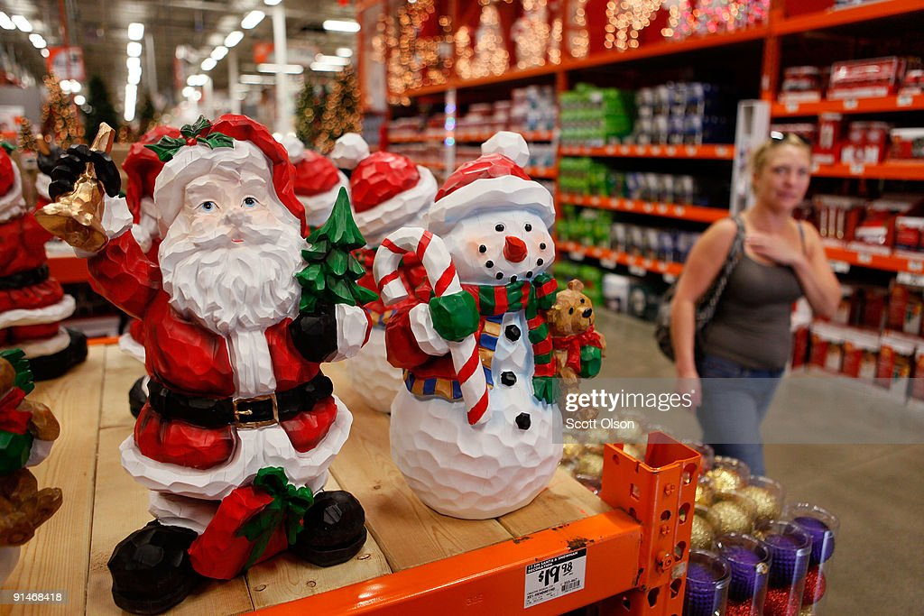 a woman walks by christmas merchandise offered for sale at a home depot store october 5 - Home Depot Holiday