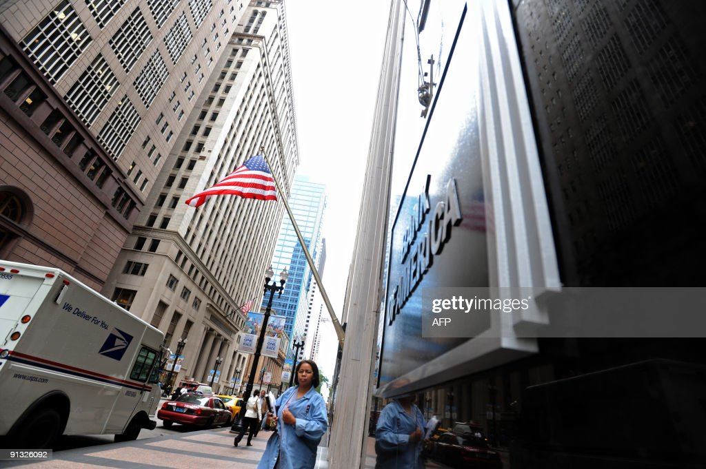 A woman walks by the Bank of America in Chicago Illinois on September 15 2008 Bank of America announced Monday it was buying Merrill Lynch for 50...