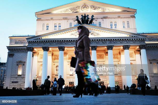 A woman walks by the Bolshoi Theatre in Moscow on March 9 2017 in Moscow Russia Relations between the United States and Russia are at their lowest...
