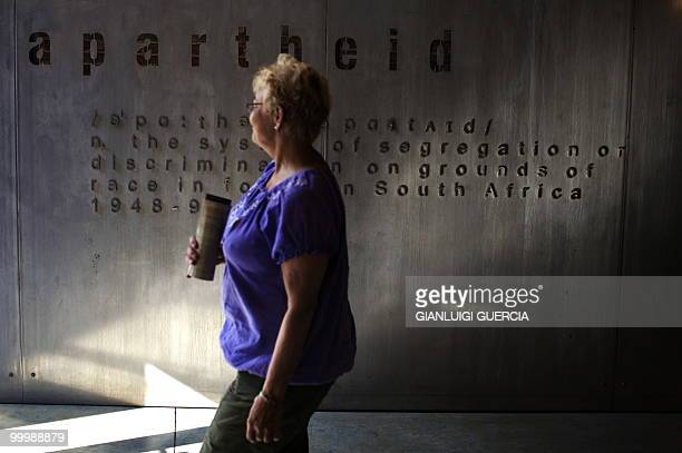 A woman walks by the main entrance to the segregation history exhibition on May 19 2010 at the Apartheid museum in Johannesburg South Africa The...