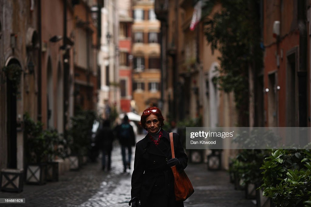 A woman walks down a cobbled street in the Campo de' Fiori area on March 25, 2013 in Rome, Italy. Pope Francis is expected to inspire an influx of tourism from the Americas to Rome as the first South America Pope at The Vatican.