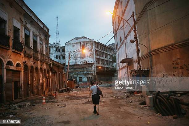 A woman walks down a demolished street still under reconstruction in the Port Zone part of the Marvelous Port project on March 30 2016 in Rio de...