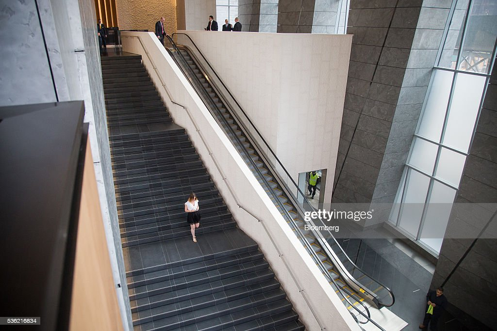 A woman walks down a flight of stairs during the opening of Coach Inc.'s new offices at 10 Hudson Yards in New York, U.S., on Tuesday, May 31, 2016. The first skyscraper at Related Cos.'s $25 billion Hudson Yards project opened Tuesday after three and a half years of construction, bringing office workers to a once-desolate area of Manhattan's far west side that's now transforming into a new business enclave. Photographer: Michael Nagle/Bloomberg via Getty Images