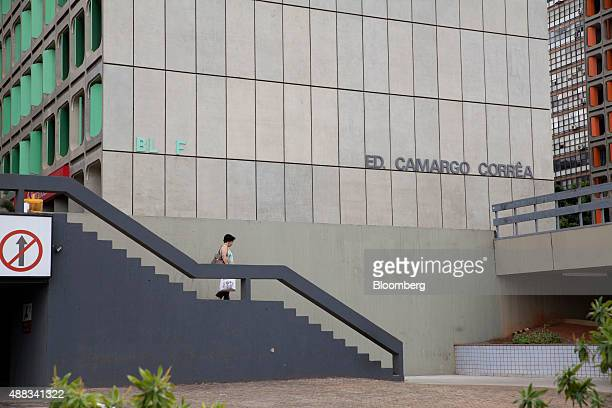 A woman walks down a set of stairs outside the offices of Camargo Correa SA in downtown Brasilia Brazil on Wednesday Sept 9 2015 Dalton Avancini a...