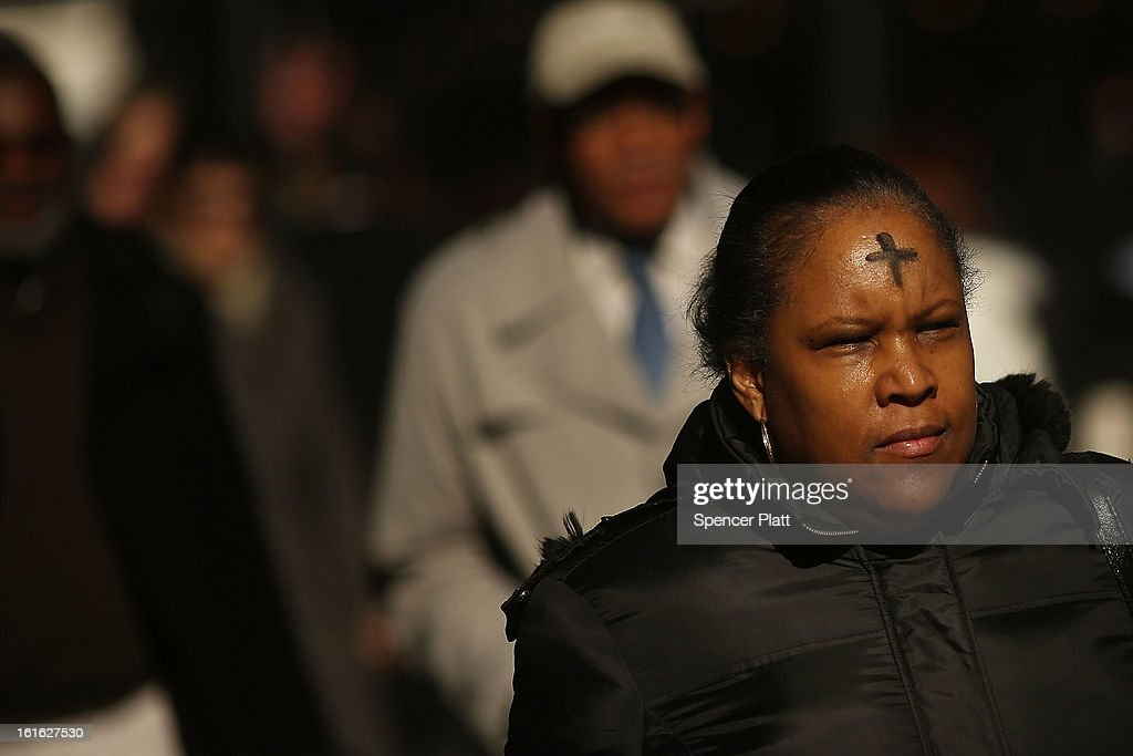 A woman walks down Broadway with a cross of black ashes on her forehead on Ash Wednesday on February 13, 2013 in New York City. Ash Wednesday marks the beginning of Lent, a 40-day period of pray and fasting for many Christians.