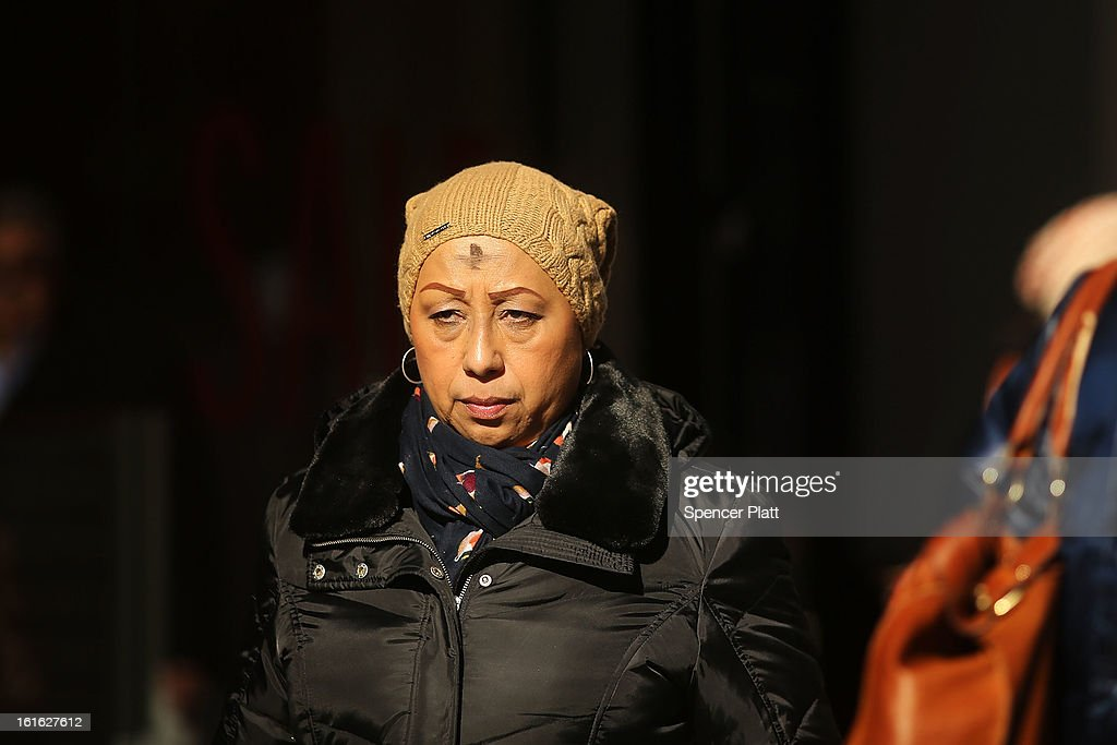A woman walks down Broadway with a cross of black ashes on his forehead on Ash Wednesday on February 13, 2013 in New York City. Ash Wednesday marks the beginning of Lent, a 40-day period of pray and fasting for many Christians.