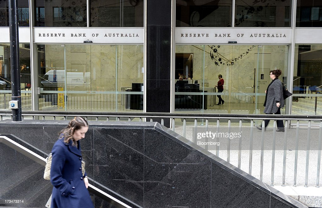 A woman walks down stairs as another walks past the Reserve Bank of Australia (RBA) headquarters in the central business district of Sydney, Australia, on Monday, July 15, 2013. While the RBA previously needed higher interest rates to control price pressures as the Australian economy expanded since 1991 without a recession, Governor Glenn Stevens has slashed the cash target, predicting a mining boom will wane. Photographer: Dan Himbrechts/Bloomberg via Getty Images