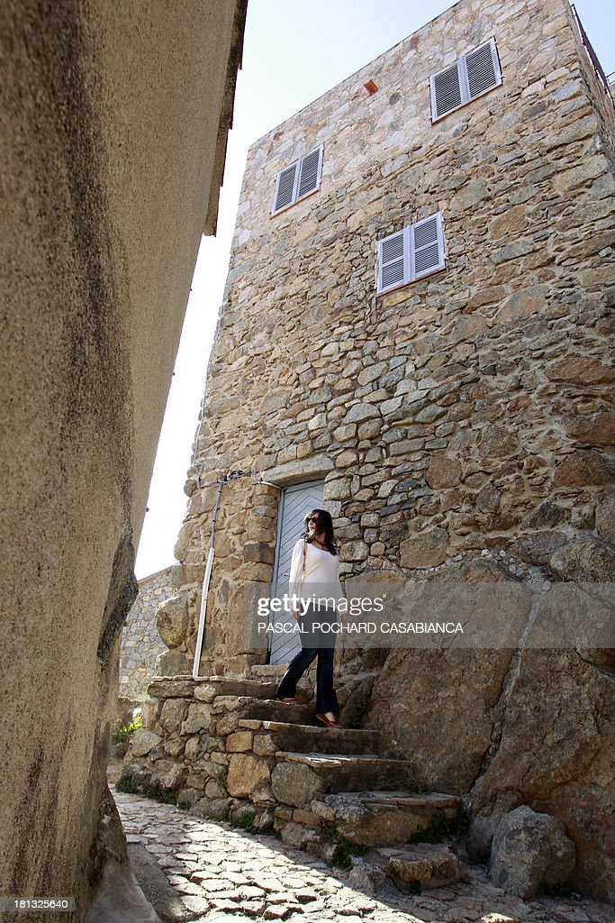 A woman walks down stairs on September 19, 2013, in the village of San Antonino on the French Mediterranean island of Corsica. San Antonino is listed as one of the most beautiful villages of France.