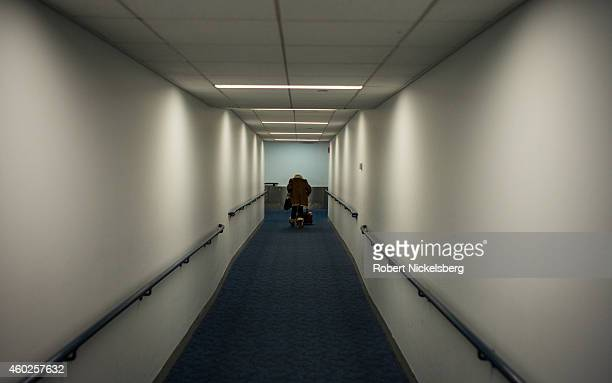 A woman walks down the gangway before boarding an American Airlines jet aircraft November 28 2014 at New York City's John F Kennedy International...