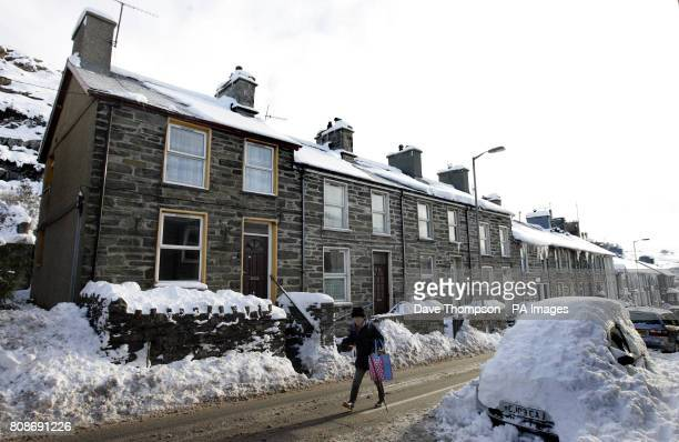 A woman walks down the middle of the road in Blaenau Ffestiniog North Wales after temperatures plunged overnight