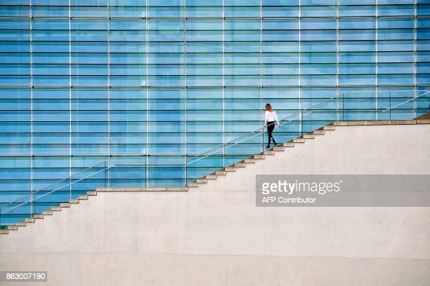 A woman walks down the stairs of the MarieElisabethLueders house in Berlin on October 19 2017 / AFP PHOTO / Tobias SCHWARZ