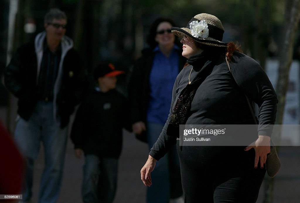 A woman walks down the street April 6, 2005 in San Francisco. According to a study released Tuesday, almost 53 percent of Californians over 25 are overweight, and more than 17 percent are obese, or extremely overweight and are costing nearly $21.7 billion a year in medical bills, injuries and lost productivity.