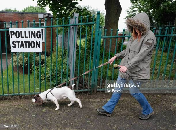 A woman walks her dog past a polling station on June 8 2017 in Carlin How United Kingdom Polling stations open across the country as the United...