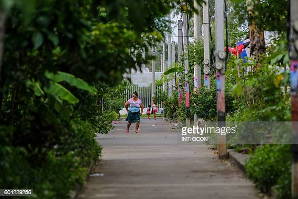 A woman walks in a street of the 'Ciudadela heroes del Nemagón' a new neighborhood with social housing for people who got their homes after years...