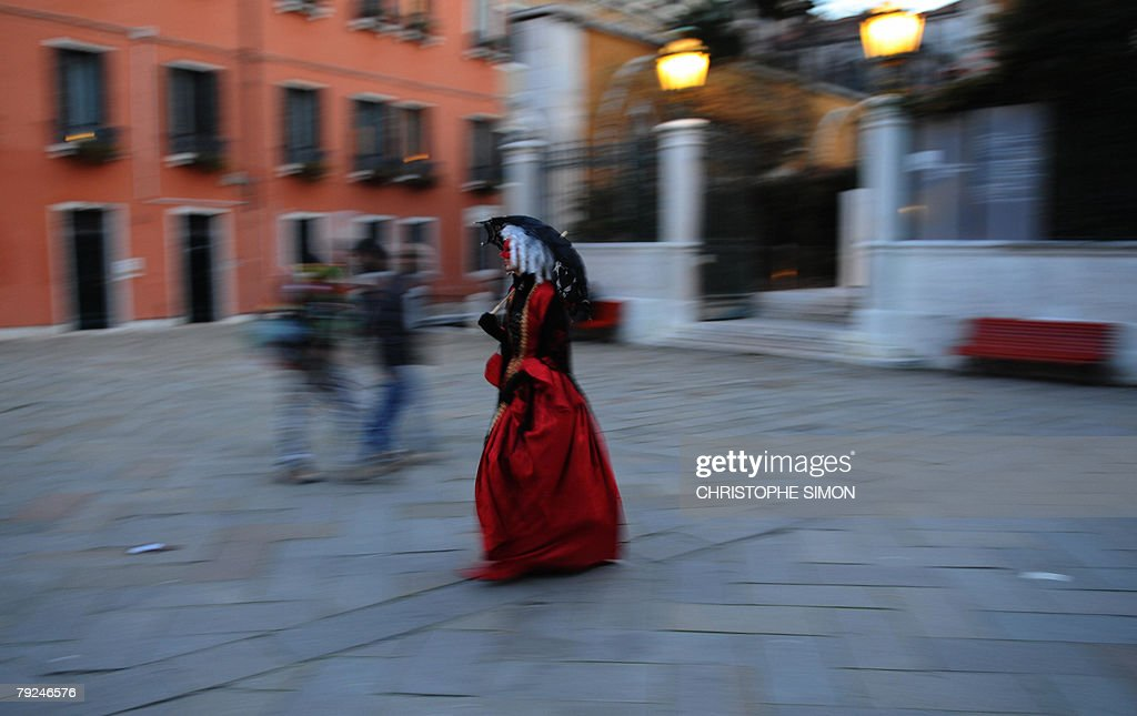 A woman walks in downtown Venice two days before the beginning of the Venice Carnival 25 January 2008.