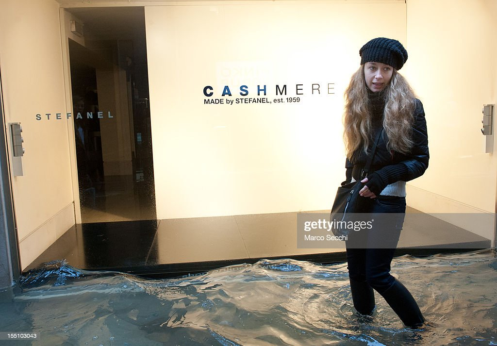 A woman walks in front of an empty shop window during heavy floods on November 1, 2012 in Venice, Italy. More than 59% of Venice has been been left flooded, after the historic town was hit by exceptionally high tides. The sea level rose above 140cm overnight was expected to remain above critical levels for about 15 hours.
