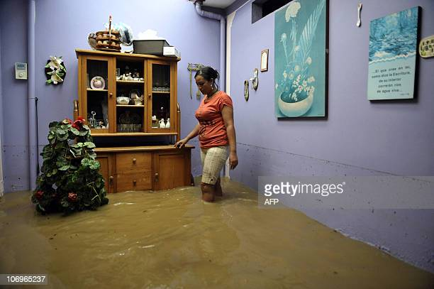 A woman walks in her flooded house on November 17 in Jamundi department of Valle del Cauca Colombia The Jamundi river overflowed its banks due to...