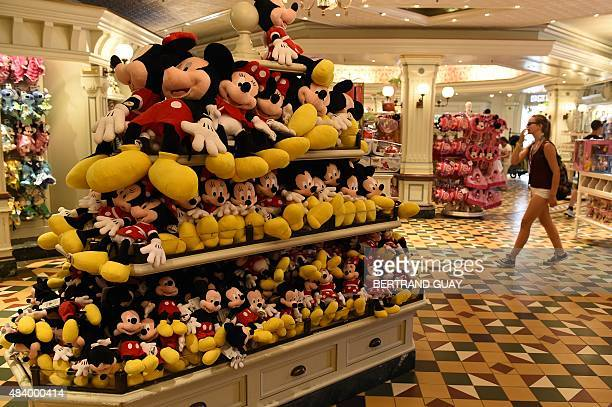 A woman walks in shop near Mickey and Minnie Mouse stuffed animals in the Disney Store in Mean Street at Disneyland Paris in MarnelaVallee east of...