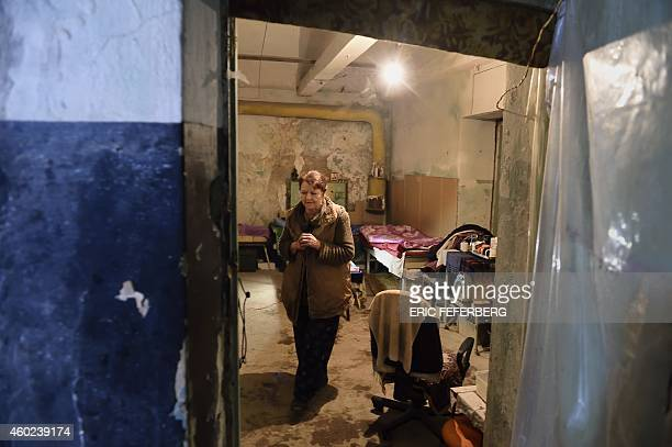 A woman walks in the cellar of his building used as a shelter in Kievskiy district witch is often sheld in the eastern Ukrain city of Donetsk...
