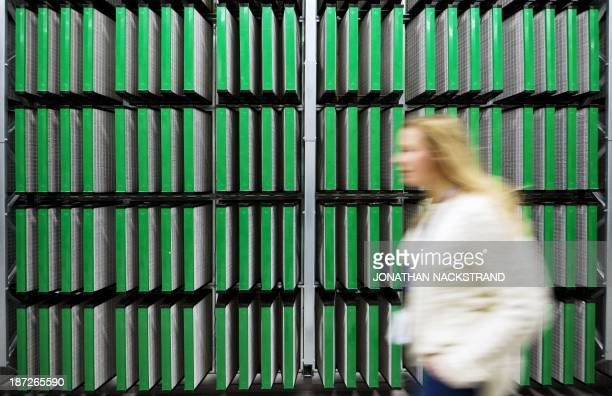 A woman walks in the Coil Room of the first server rooms is pictured in the new Facebook Data Center its first outside the US on November 7 2013 in...