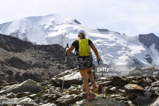 A woman walks in the famous 'Couloir du Goûter' on the 'voie royale' route to climb atop the MontBlanc peak on August 27 2017 in the MontBlanc range...