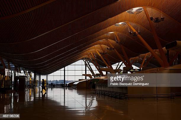 A woman walks inside Madrid Barajas Adolfo Suarez airport which is operated by group Aena on February 11 2015 in Madrid Spain Shares in...