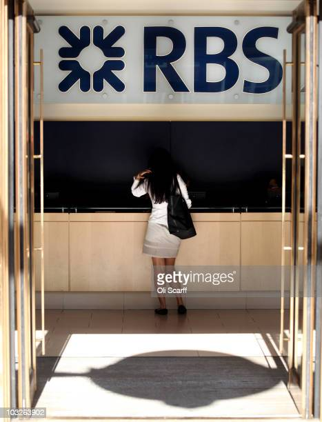 A woman walks into a branch of The Royal Bank of Scotland in the City of London on August 6 2010 in London England RBS which is 84% owned by the...