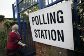 A woman walks into a polling station for local elections at a school in north London on May 3 2012 Voters went to the polls in local elections in...