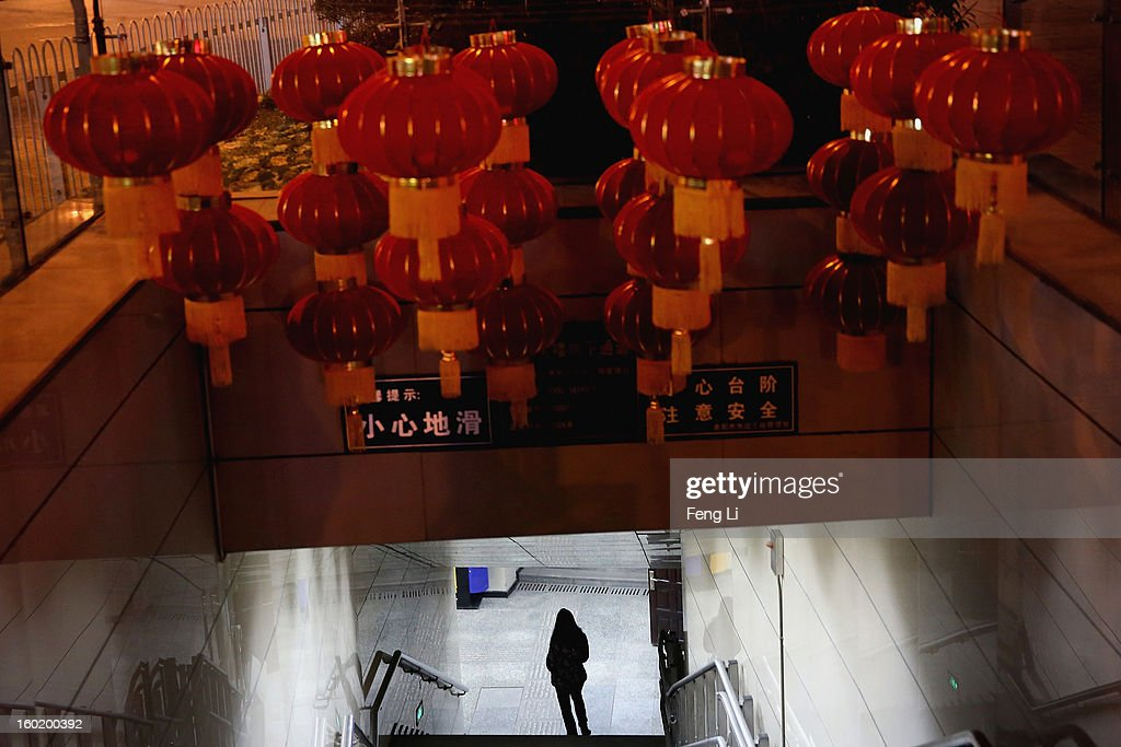 A woman walks into a underground passage decorated with red lanterns for celebrating the Chinese Spring Festival on January 27, 2013 in Guiyang of Guizhou Province, China.
