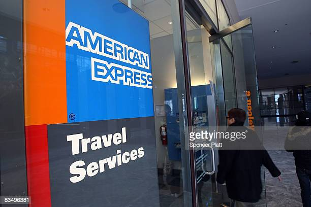 A woman walks into an American Express travel agency inside the American Express headquarters October 30 2008 in New York City American Express a...