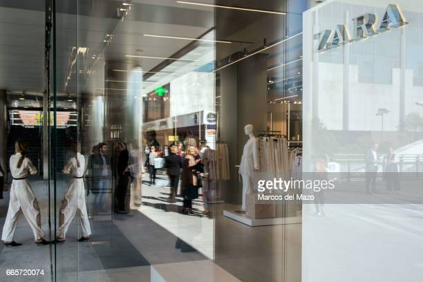 A woman walks into the world's biggest Zara during the opening day The store has 6000 square meters