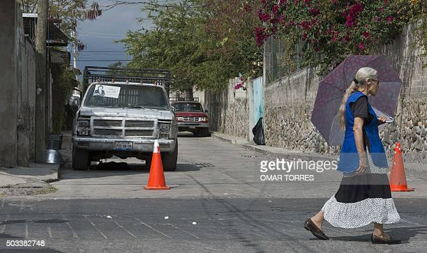 A woman walks near the house of Gisela Mota the mayor who was gunned down a day after taking office in Temixco Morelos State Mexico on January 4 2016...