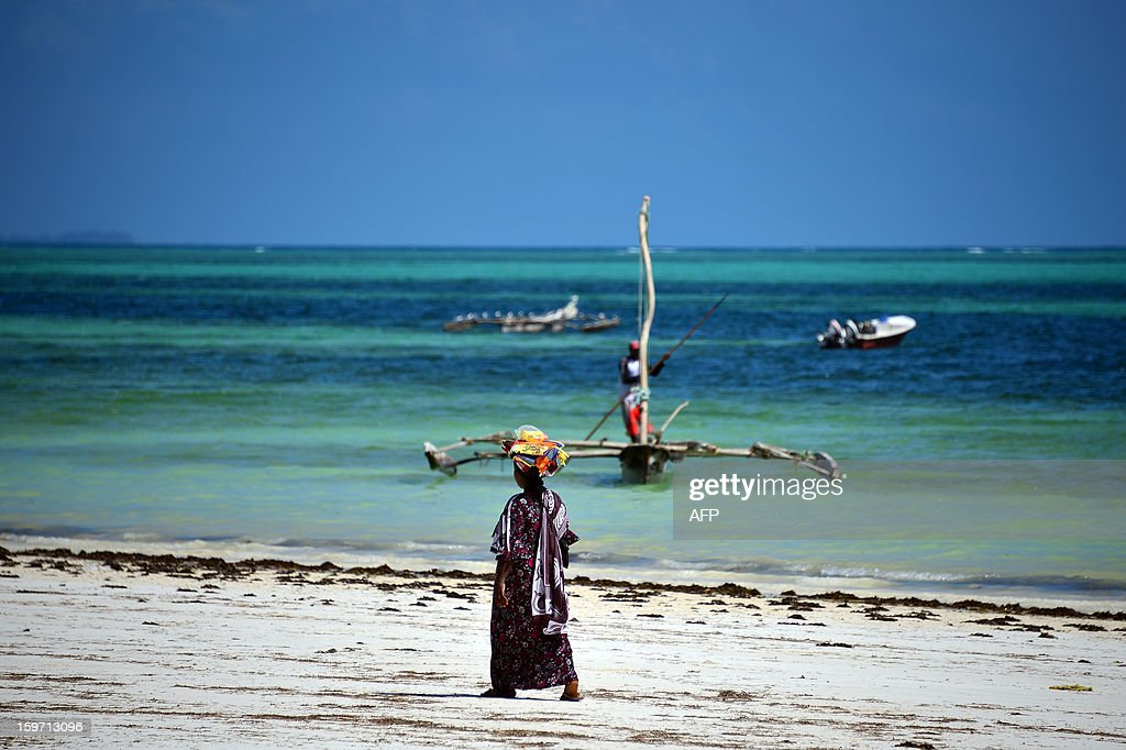 A woman walks on a beach on January 8, 2013 in Zanzibar.