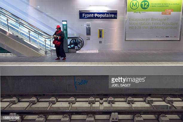 A woman walks on the platform of the Front Populaire subway station on its inauguration day on December 18 2012 in AubervilliersSaintDenis north of...