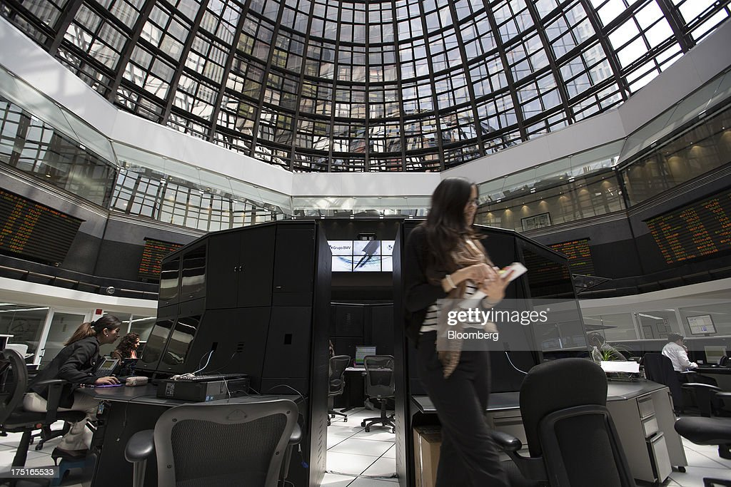 A woman walks on the trading floor of the Bolsa Mexicana de Valores (BMV), at the Mexican Stock Exchange building in Mexico City, Mexico, on Wednesday, July 31, 2013. Mexico's economy is forecast to grow 2.8 percent this year based on analyst estimates compiled by Bloomberg. Photographer: Susana Gonzalez/Bloomberg via Getty Images
