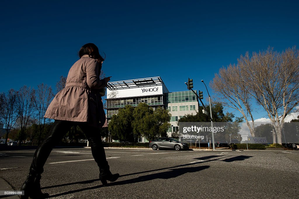 A woman walks on the Yahoo Inc headquarters corporate campus in Sunnyvale California US on Thursday Jan 7 2016 Yahoo Inc is planning to eliminate...