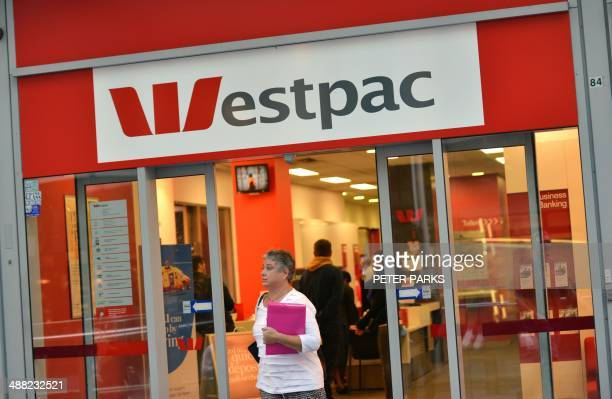 A woman walks out of a Westpac Bank in the central business district of Sydney on May 5 2014 Australian banking heavyweight Westpac announced a 10...