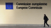 A woman walks out of the Berlaymont building at EU headquarters in Brussels on December 6 2010 AFP PHOTO / JOHN THYS