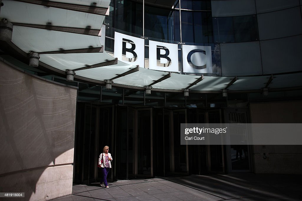 A woman walks out of the Broadcasting House the headquarters of the BBC on July 25 2015 in London England The main Art Decostyle building of the...