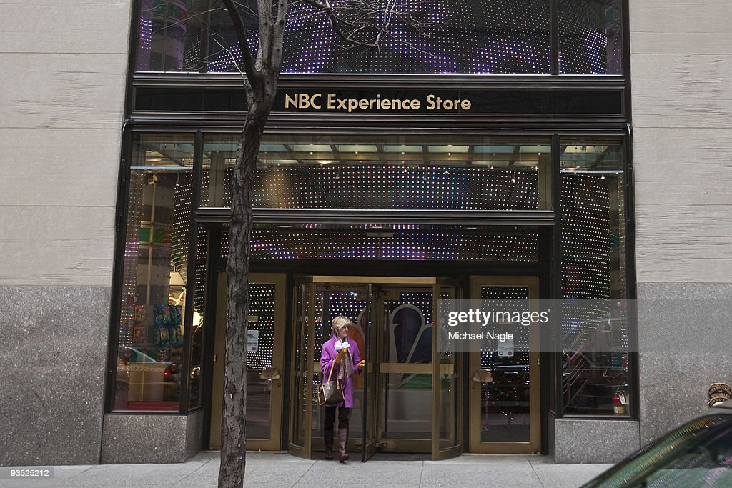 A woman walks out of the NBC Experience Store at Rockefeller Center on December 1, 2009 in New York City. General Electric is poised to buy Vivendi's NBC Universal stake.