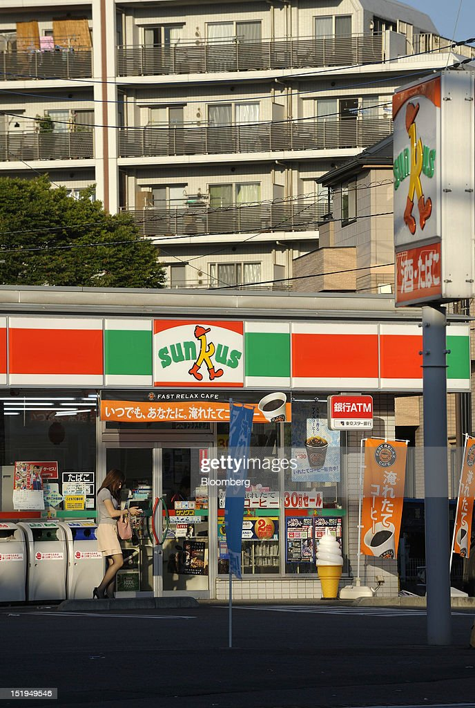 A woman walks outside a Sunkus convenience store, operated by Circle K Sunkus Co., in Yokohama City, Kanagawa Prefecture, Japan, on Tuesday, Sept. 11, 2012. Sales at Japan's convenience stores declined 3.3 percent in July from a year ago on a same-store basis, according to the Japan Franchise Association. Photographer: Akio Kon/Bloomberg via Getty Images